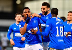 On target: Alfredo Morelos is mobbed after scoring Rangers' second goal in the win over St Mirren