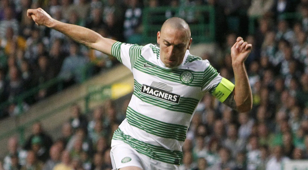 Celtic's Scott Brown and Shakhter Karagandy's Gediminas Vicius fight for the ball during the UEFA Champions League Play-Off match
