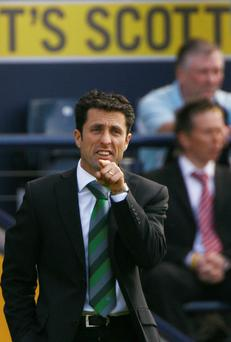 GLASGOW, UNITED KINGDOM - APRIL 15: John Collins coach of Hibernian gestures to his players during the Tennent's Scottish Cup Semi Final between Hibernian and Dunfermline Athletic at Hampden Park April 15, 2007 in Glasgow, Scotland. (Photo by Jeff J Mitchell/Getty Images)