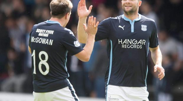 Head boy: James McPake receives the plaudits after scoring in the opening moments for Dundee against Celtic