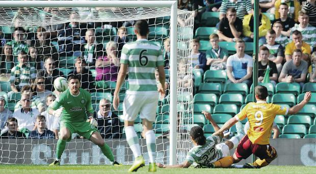 Wel done: Motherwell's John Sutton puts his side in front against Celtic