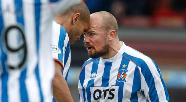 No ban: Josh Magennis and Jamie Hamill clash