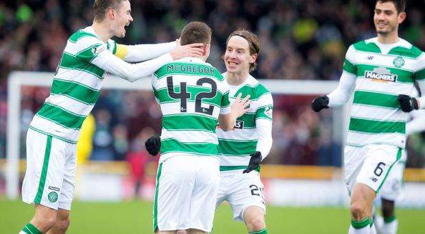 Man of the moment: Callum McGregor is congratulated by Celtic team-mates after opening the scoring against Inverness