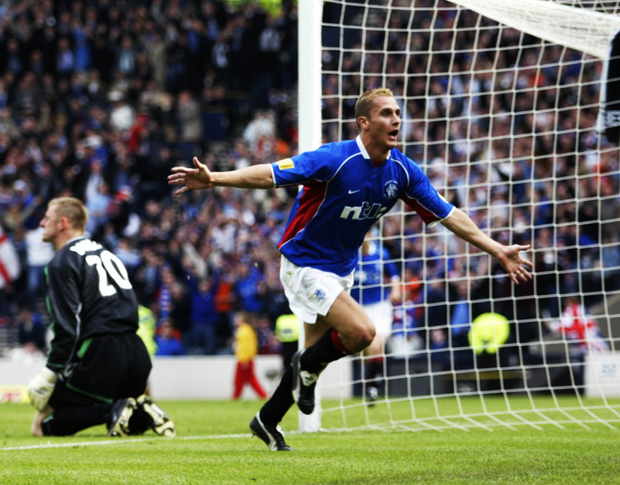 Loving it: Peter Lovenkrands celebrates his late winner for Rangers against Celtic in the 2002 Scottish Cup Final at Hampden Park