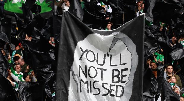 False farewell: Celtic fans unfurled a banner claiming they would not miss Rangers after their liquidation, but the Bhoys are glad their rivals are back