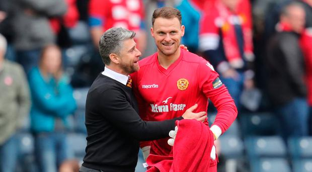Well in: Stephen Robinson and NI goalkeeper Trevor Carson