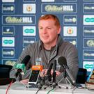 Confident: Hoops boss Neil Lennon addresses media yesterday
