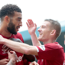 Get in: Steven Davis celebrates with scorer Connor Goldson against Saints