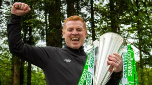 Still mine: Neil Lennon with SPL trophy after confirmation this week that he'd won it again