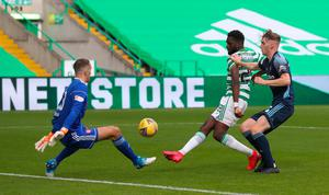Cool customer: Odsonne Edouard strokes home his second goal to put Celtic 3-1 up