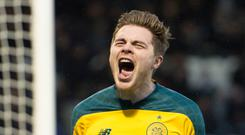 Roaring success: James Forrest celebrates his goal during Celtic's Boxing Day victory over St Mirren