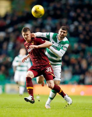 Race on: Motherwell's Ben Hall and Celtic ace Nadir Ciftci battle for possession