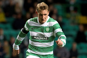 Kris Commons has penned a two-year deal