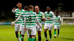 Goal routine: Leigh Griffiths is centre of attention after opening the scoring for Celtic