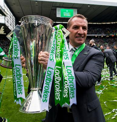 Celtic manager Brendan Rodgers celebrates with the league trophy