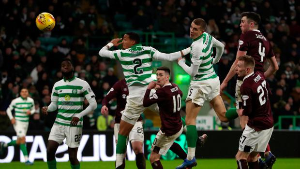 Finishing touch: Jozo Simunovic nods home Celtic's fifth