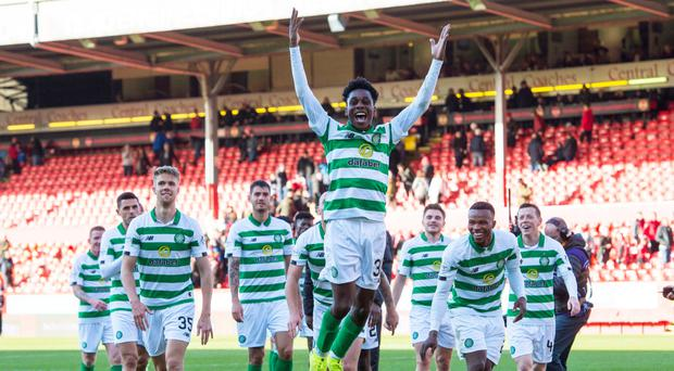 Jumping for joy: Jeremie Frimpong leads the Celtic celebrations after overcoming Aberdeen
