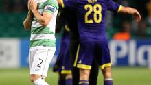 Down and out: Celtic's Adam Matthews after their defeat
