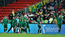Centre of attention: James Forrest is mobbed by Celtic team-mates after his goal