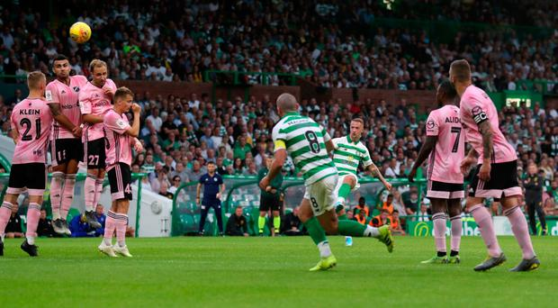 Inch perfect: Leigh Griffiths nets Celtic's third with a delightful free-kick