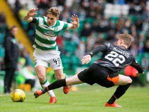 Close battle: Celtic's James Forrest clashes with Kilmarnock's Kevin McHattie during the Premiership clash