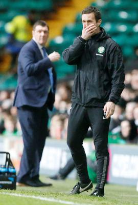 Up and down: It was a night of contrasting fortunes for Celts' Ronny Deila and Saints' Tommy Wright