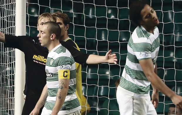 Oh no: Celtic captain Scott Brown can't believe it as another chance goes begging during their defeat to Morton