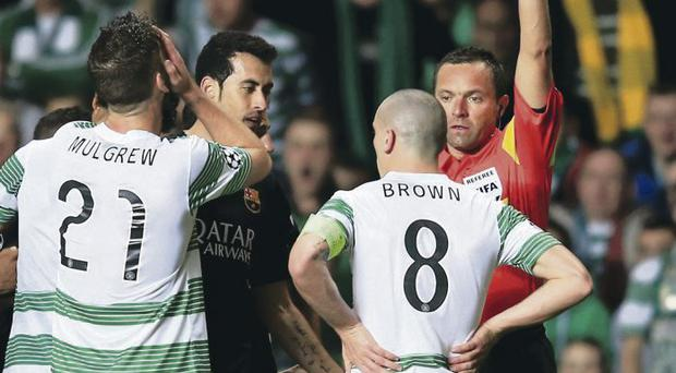 Celtic skipper Scott Brown is red carded against Barcelona at Parkhead last night