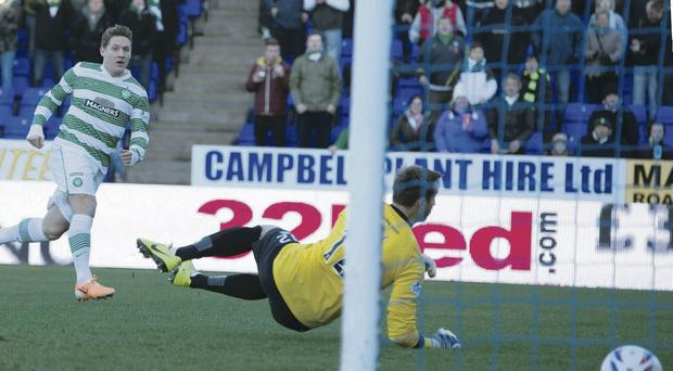 Kris Commons slots home the only goal of the game in Celtic's win at Inverness