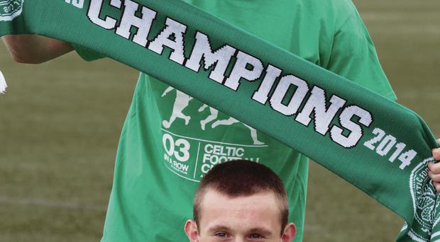 We are the champions: Celtic's Anthony Stokes and Liam Henderson show off some of the club merchandise celebrating their Scottish Premiership title triumph