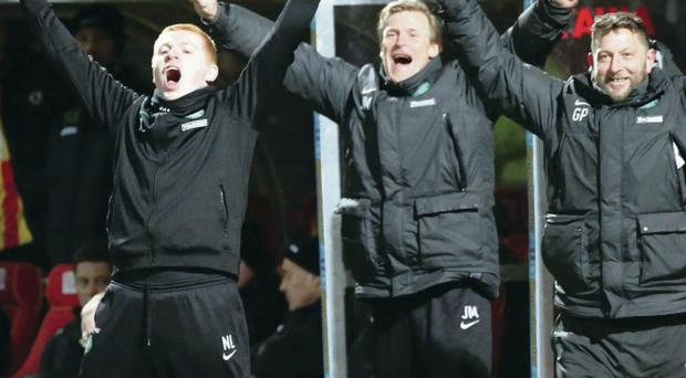 Champion feeling: Neil Lennon, Johan Mjallby and Garry Parker enjoy the moment as Celtic wrapped up the Scottish title