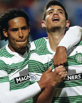 Looking up: Celtic's Nir Bitton (left) celebrates his goal with team mate Virgil Van Dijk during the Scottish Premier League match at McDiarmid Park, Perth last night