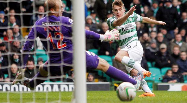 Neat finish: James Forrest scores Celtic's second goal in their 4-1 win over St Mirren