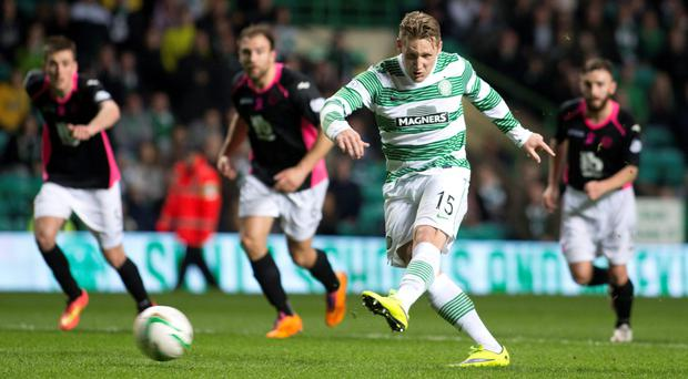 Spot on: Celtic's Kris Commons drills home a penalty