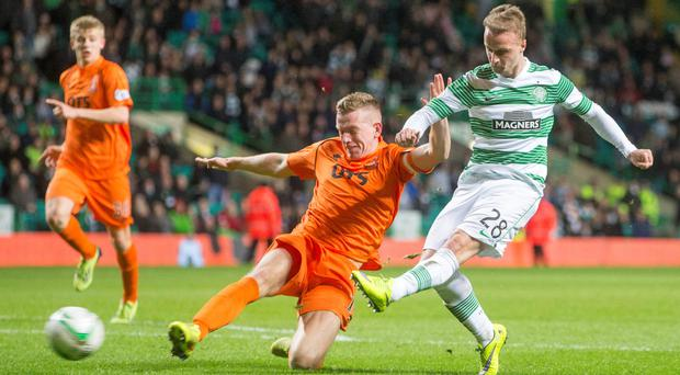 Smash hit: Celtic's Leigh Griffiths completes his hat-trick against Kilmarnock at Celtic Park