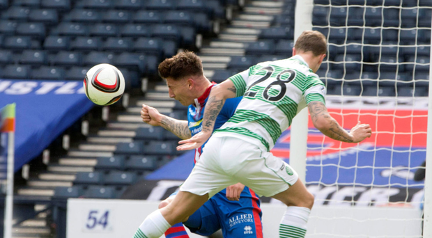 Helping hand: Josh Meekings uses his arm to stop Leigh Griffiths' header finding the net but the officials fail to spot it