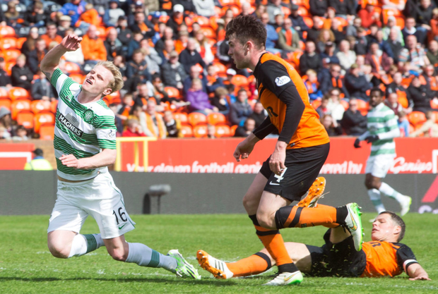 Controversial call: Celtic's Gary Mackay-Steven is brought down to win his side a penalty against Dundee United