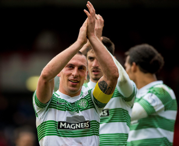 Winning strike: Scott Brown applauds Celtic fans after his goal secured victory over Aberdeen