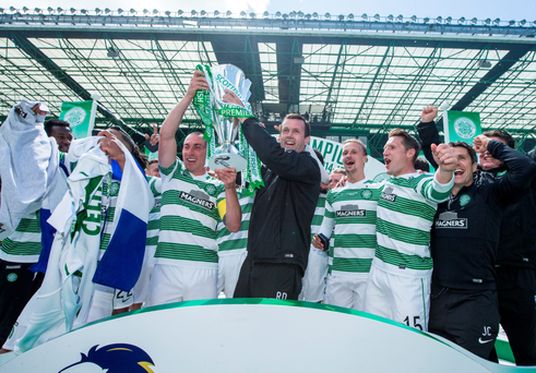 Prize guys: Celtic manager Ronny Deila and skipper Scott Brown lift the Scottish Premiership trophy at Parkhead
