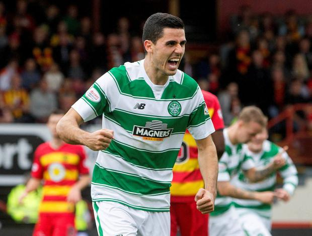 Up and running: Tom Rogic is all smiles after netting his first goal for the Hoops against Partick Thistle