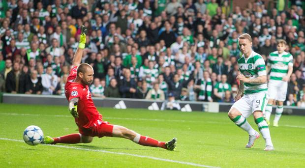 Celtic's Leigh Griffiths scores his side's first goal of the game