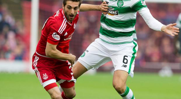 Battle is on: Aberdeen's Graeme Shinnie (left) and Celtic's Nir Bitton fight for possession