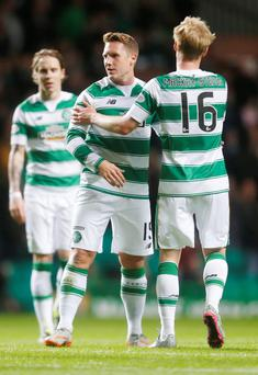 Cock-a-hoop: Celtic's Kris Commons celebrates scoring his side's first goal of the game with team-mate Gary Mackay-Steven