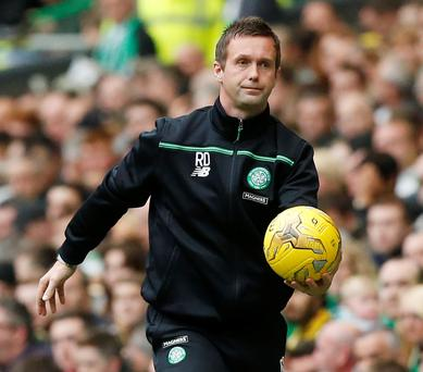 Pressure: Ronnie Deila watched Celtic lose to Ross County and now desperately needs a result