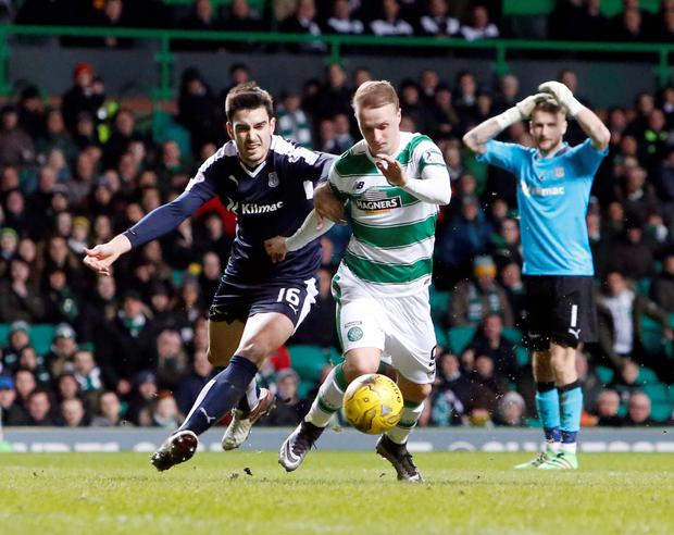 Eyes on the prize: Celtic ace Leigh Griffiths and Dundee's Julen Etxabeguren battle for the ball