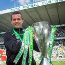 Silver lining: Ronny Deila lifts the Premiership crown after Celtic's 7-0 victory over Motherwell in his final game