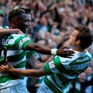 Mine's a treble: Moussa Demble celebrates scoring during the 5-1 defeat of Rangers on Saturday