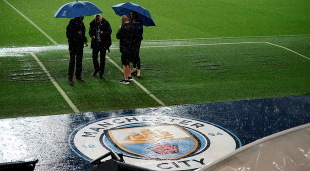 No go: torrential rain left the areas around the Etihad Stadium unsafe