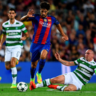 Blown away: Celtic captain Scott Brown slides in on Barcelona's Andre Gomes at the Nou Camp on Tuesday evening