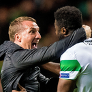 Special night: Celtic manager Brendan Rodgers celebrates with Kolo Toure after the 3-3 draw with Manchester City